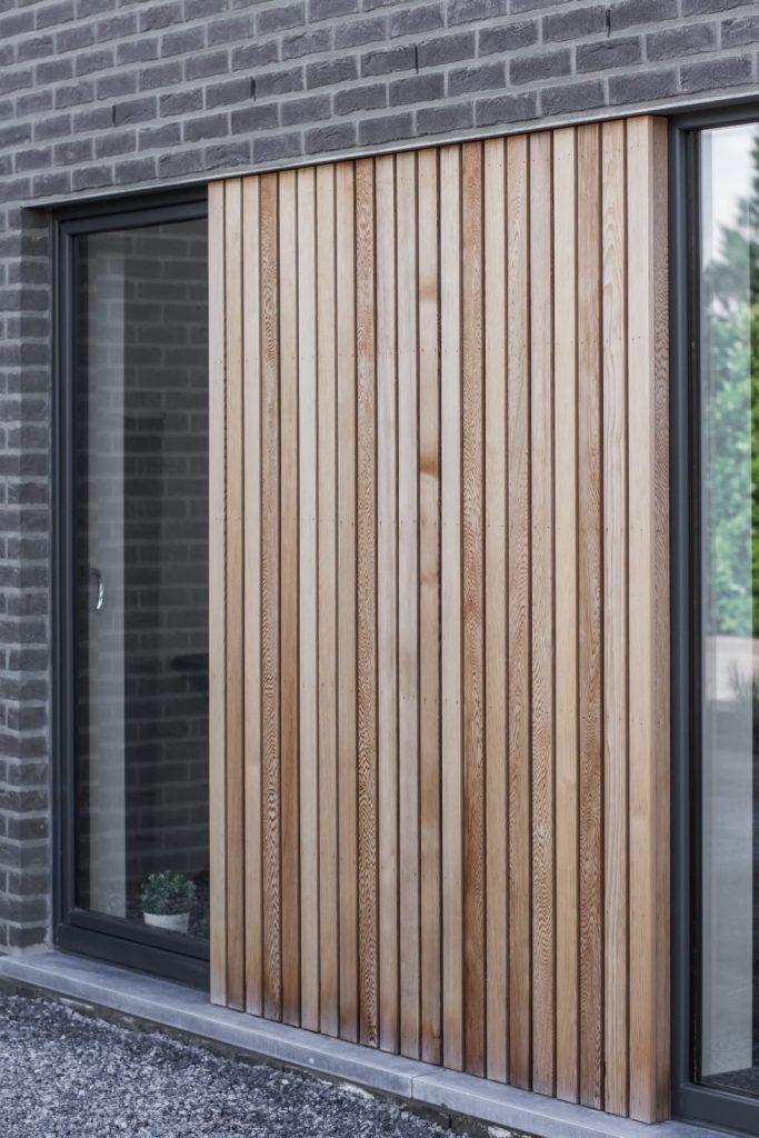 bardage facade avant maison contemporaine delta constructions